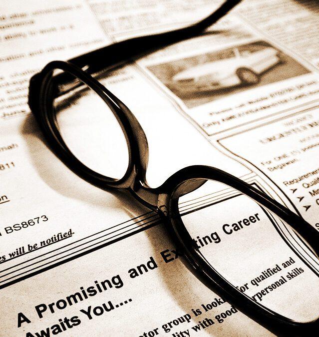 job posting and an eyeglass